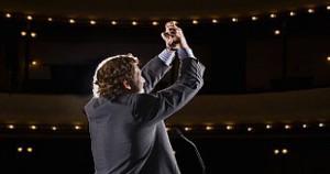 Leadership_Businessman in Auditorium